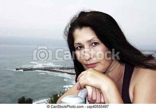 Woman near the sea in a public park - csp40555497