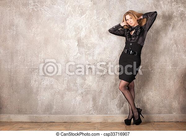 Woman near the wall  - csp33716907
