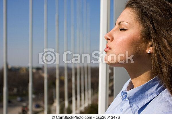 woman near the window - csp38013476