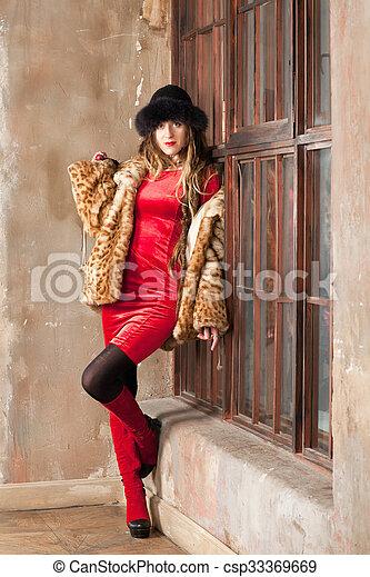 Woman near the window - csp33369669
