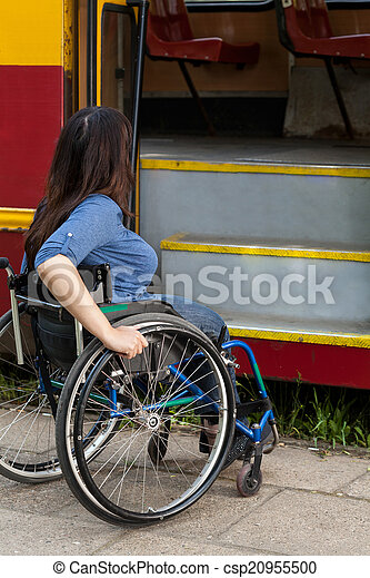 Woman of wheelchair having problem with public transport - csp20955500