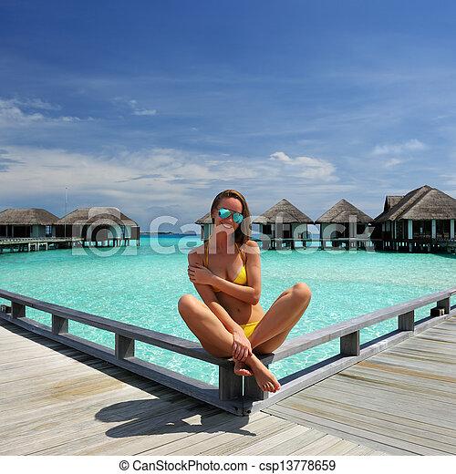 Woman on a beach jetty at Maldives - csp13778659