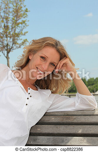 woman on a bench - csp8822386