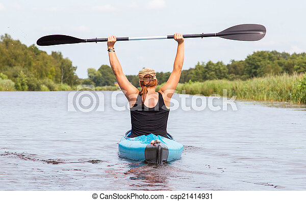 Woman on a small river in rural landscape - csp21414931
