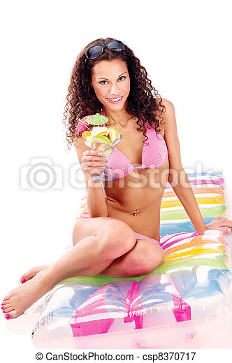 woman on air mattress holding cup of fruits - csp8370717