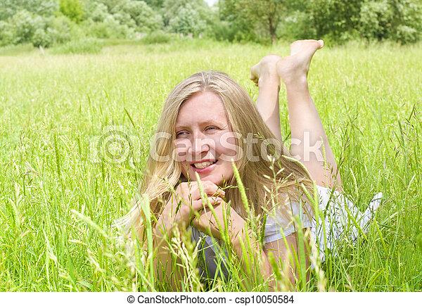 woman on green grass - csp10050584