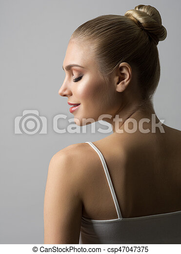 Woman on grey background - csp47047375