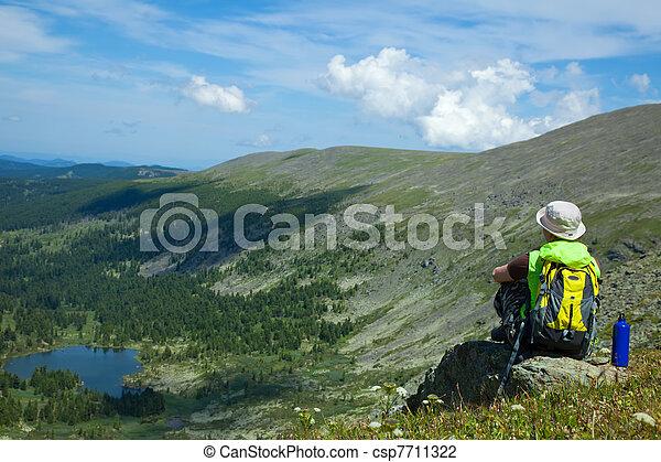 Woman on mountain peak - csp7711322