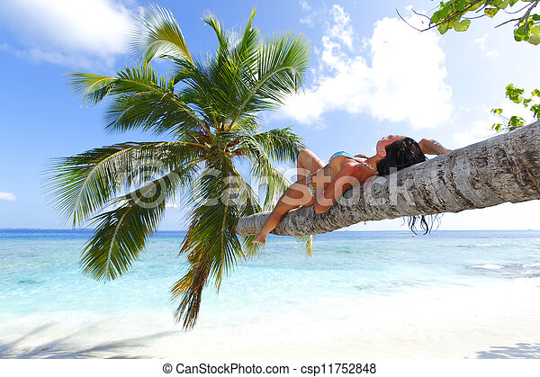 Woman on palm on sea backgroud - csp11752848
