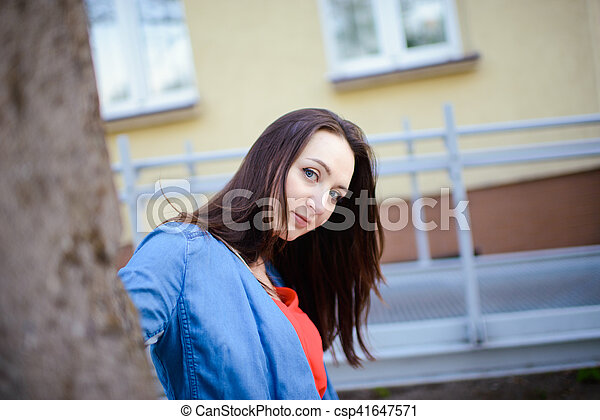 Woman on sidewalk in the city - csp41647571