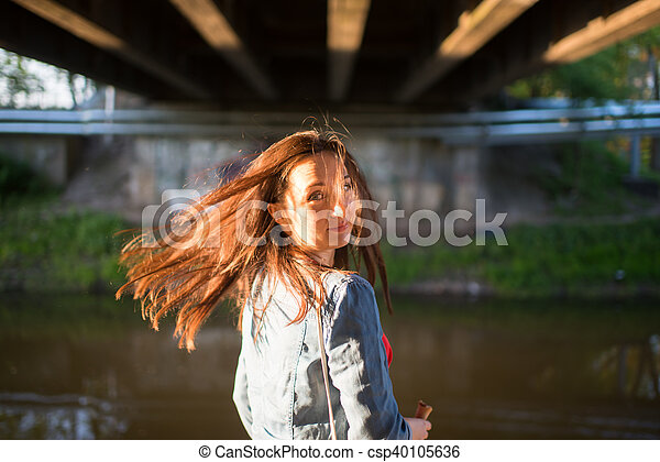 Woman on sidewalk in the city - csp40105636