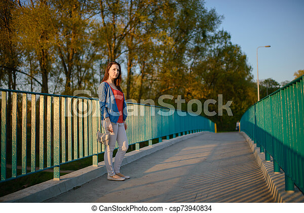 Woman on sidewalk in the city - csp73940834