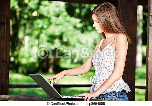 woman on sunny day in park - csp8654888