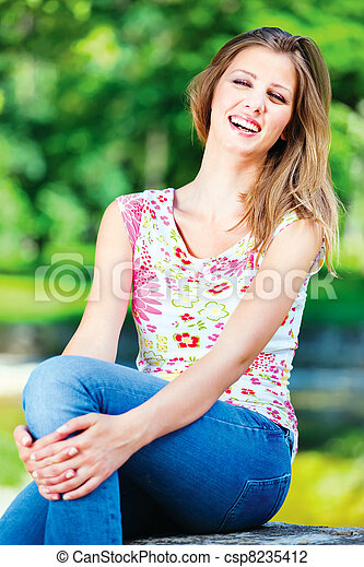 woman on sunny day in park - csp8235412
