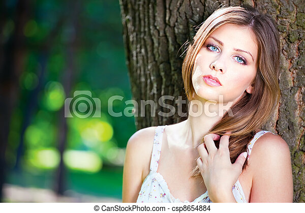 woman on sunny day in park - csp8654884