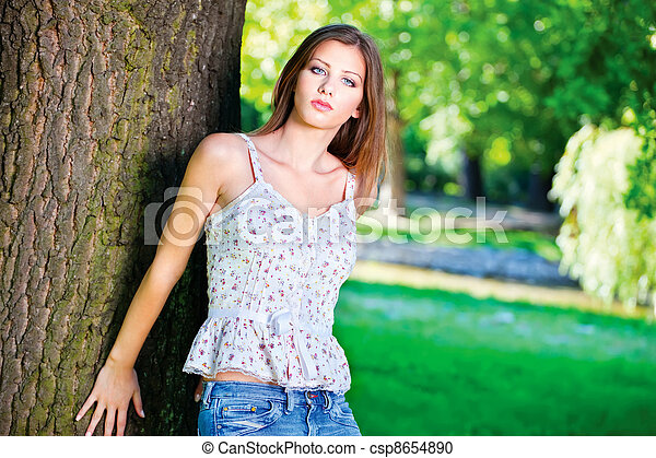 woman on sunny day in park - csp8654890