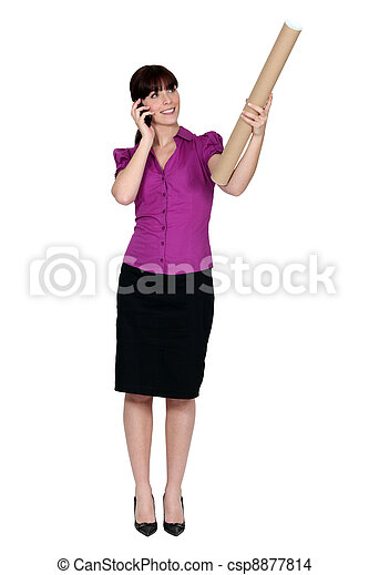 Woman on the phone and holding a cardboard mailing tube - csp8877814