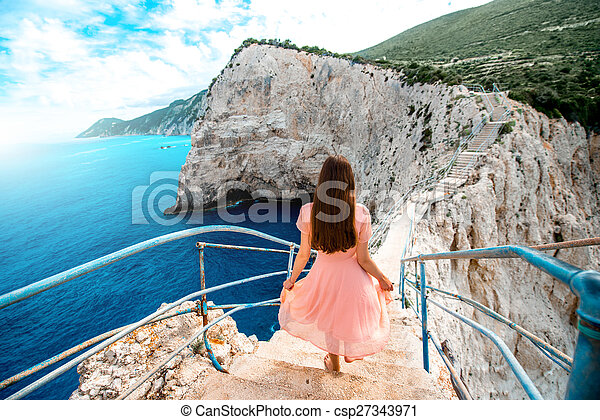 Woman on the rocky island beach - csp27343971