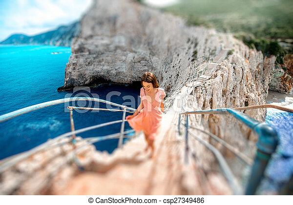 Woman on the rocky island beach - csp27349486