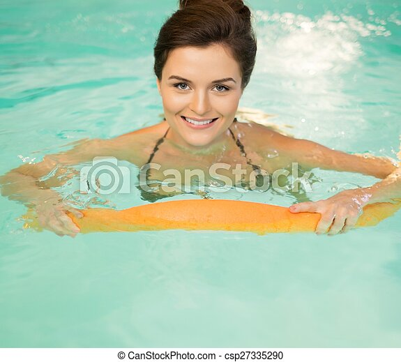 Woman on water aerobics workout - csp27335290
