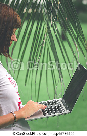 Woman Online Shopping Concept Woman In The Green Park With Modern Laptop Bali Island