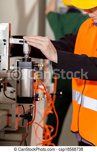 Woman operating lathe - csp18568738