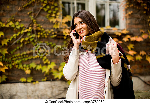 Woman outdoor with mobile phone - csp43780989
