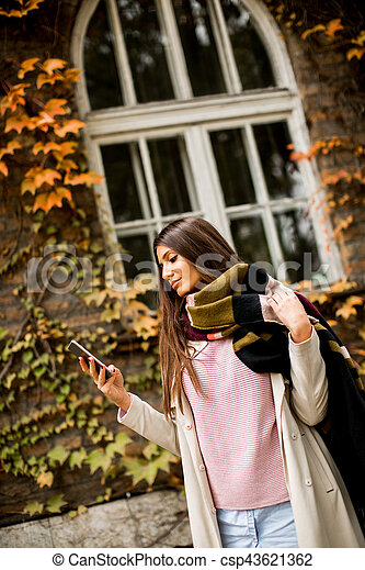 Woman outdoor with mobile phone - csp43621362