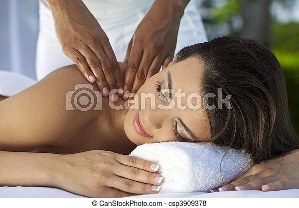 Woman Outside At Health Spa Having Relaxing Massage - csp3909378