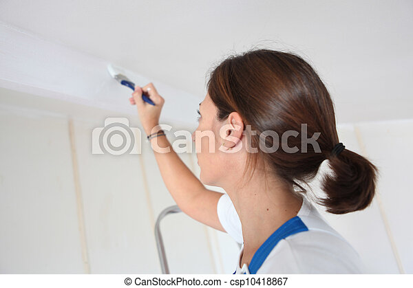 Woman painting a wall - csp10418867