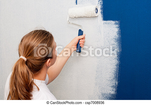 Woman painting a wall - csp7008936