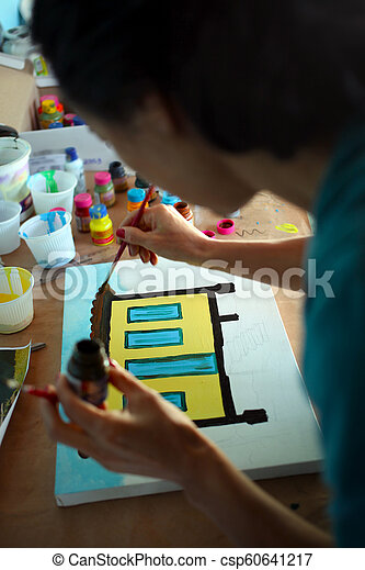 Woman painting picture - csp60641217