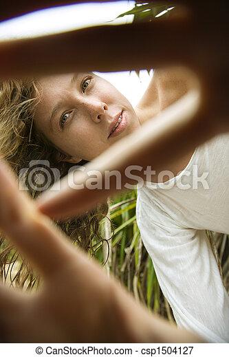 Woman peeking out. - csp1504127