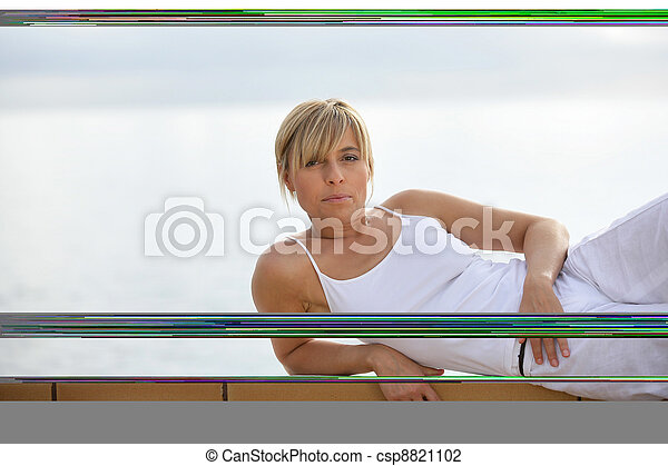 Woman performing yoga outdoors - csp8821102