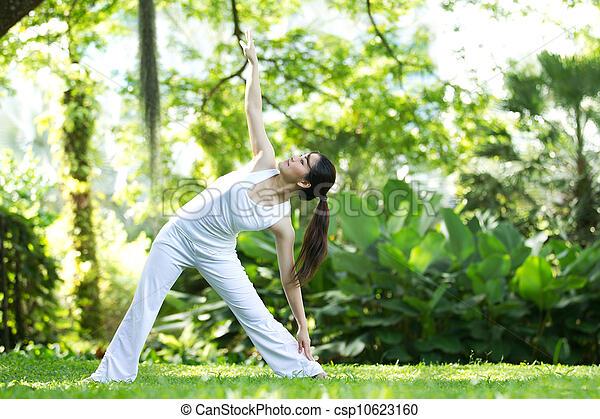 Woman performing yoga - csp10623160