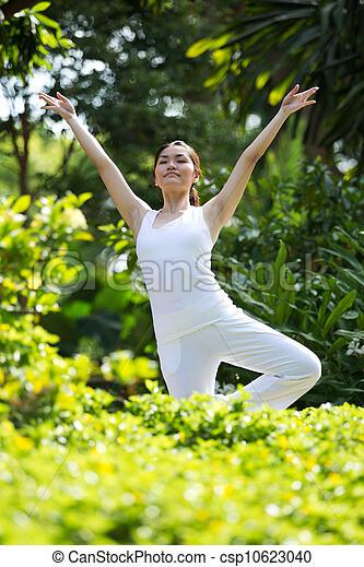 Woman performing yoga - csp10623040
