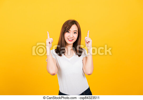 woman person standing makes gesture two fingers point upwards above - csp84323511