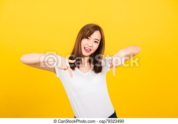woman person standing makes gesture two fingers point below - csp79323490