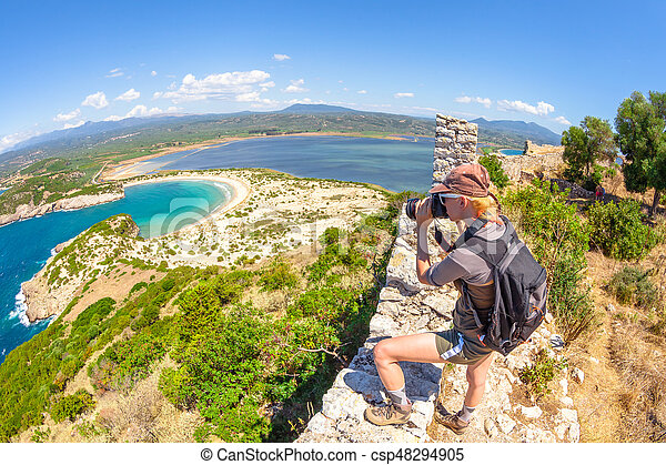 Woman photographer Navarino Castle - csp48294905