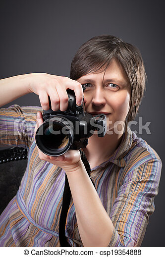 woman photographer with camera - csp19354888