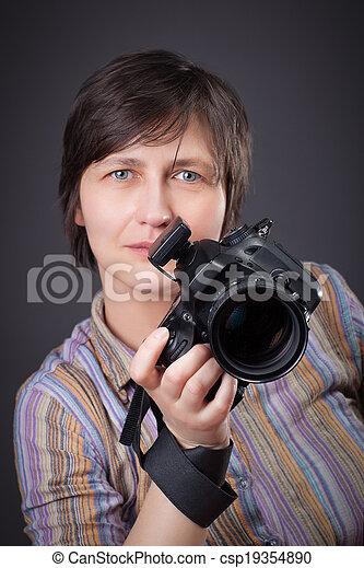 woman photographer with camera - csp19354890