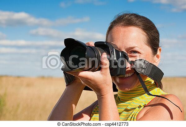 woman photographer with camera - csp4412773