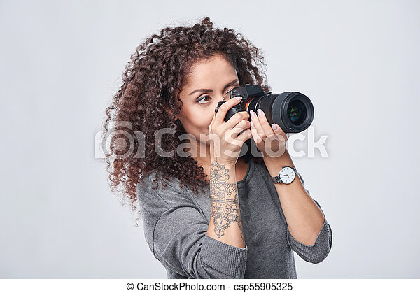 Woman photographer with professional photo camera - csp55905325
