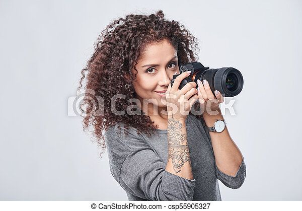 Woman photographer with professional photo camera - csp55905327