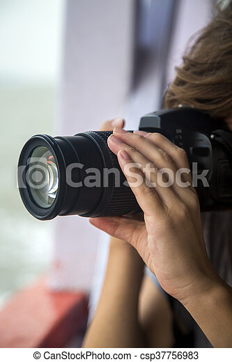 Woman photographing - csp37756983