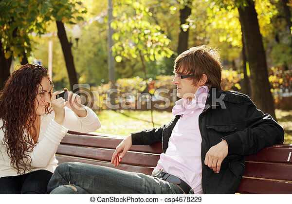 Woman photographs guy - csp4678229
