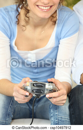 Woman playing a video game - csp10497912