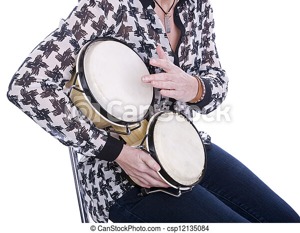 woman playing bongos with white background - csp12135084