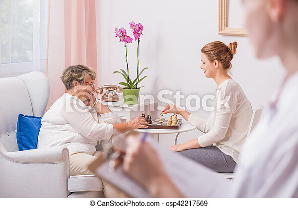 Woman playing chess with mother - csp42217569