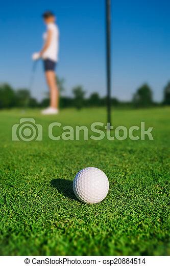 Woman playing golf - csp20884514